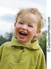 Child has fun - Boy laughs cheerfully