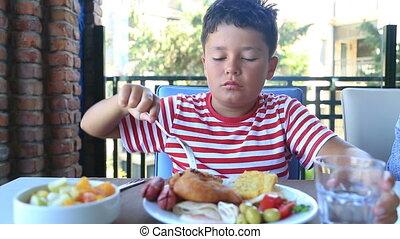 Child  having breakfast at restaurant