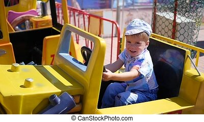 child having fun at an amusement Park.Riding the car
