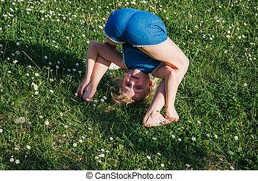 child having fun in meadow