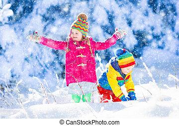 Child having fun in snowy winter park - Child running in ...