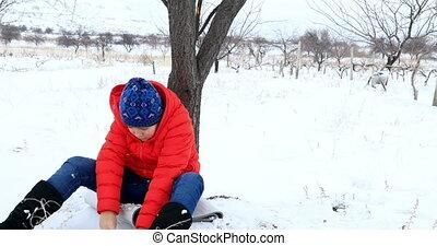 Child having fun in winter park