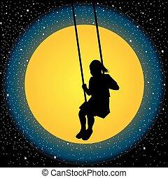 Child having fun on a swing in the night