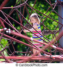 Child having fun on school yard playground