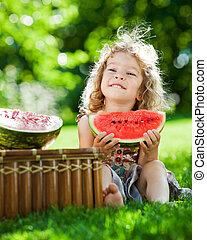 Child having picnic in spring park