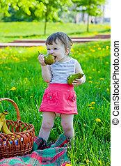 Child having picnic in summer park