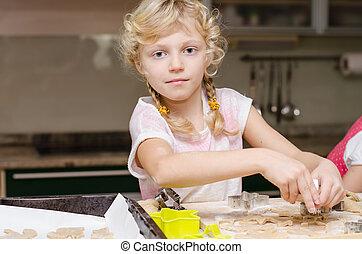 child helping in kitchen