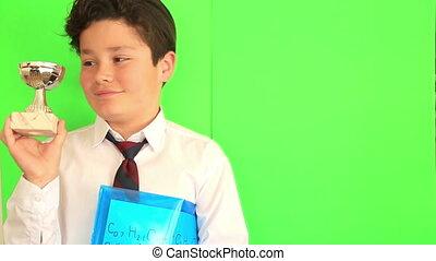 Child holding a champion trophy - Elementary school boy...