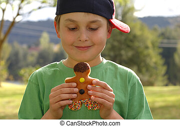 Child holding a donut