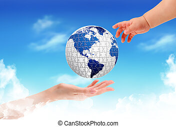 Child holding a globe in hands