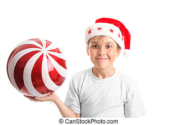 Child holding a large bauble