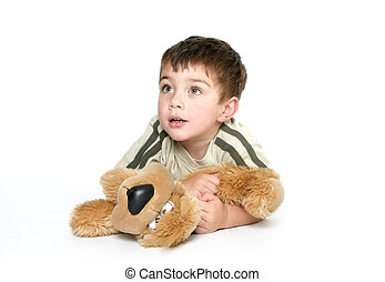Child holding a plush toy - Child dressed in casual clothes...