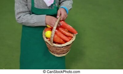 child holding a toy basket with carrots