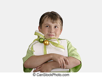 Child holding a wrapped present and thoughtfully looking up