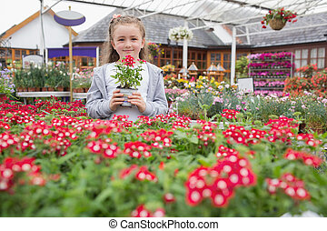 Child holding flower pot