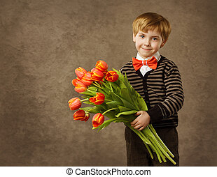 Child holding flowers bouquet. Vintage style.