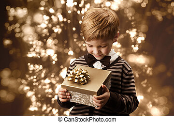 Child holding gift box, boy in vintage style.