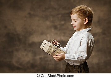 Child holding gift box. Vintage style.