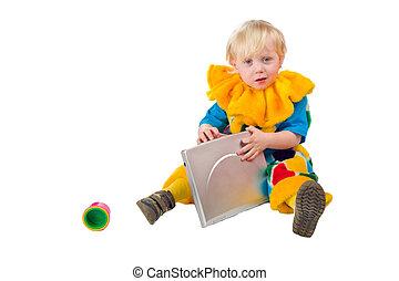 Child holding laptop