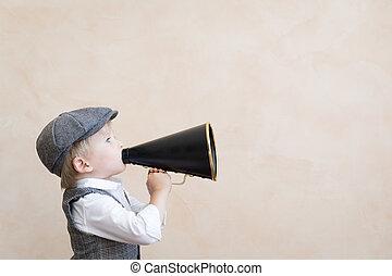 Kid shouting through vintage megaphone
