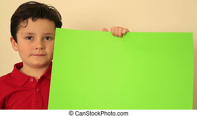 Child Holding Onto A Green Screen
