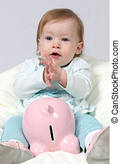 Child Holding Piggy Bank and Claping Hands