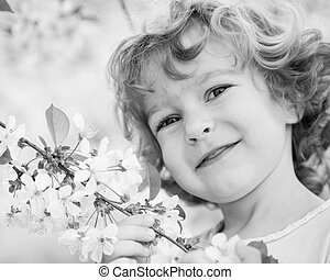 Child holding spring flower