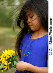 Child holding sunflowers - Child holding bouquet of...