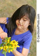Child holding sunflowers
