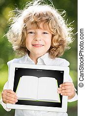 Child holding tablet PC with ebook
