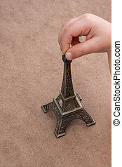 Child holding the little model of Eiffel Tower
