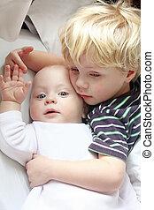 Child Hugging New Baby