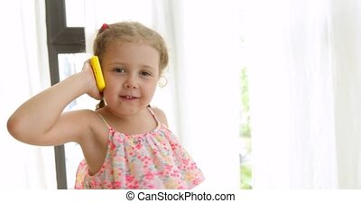 Emotional girl talking on an toy phone