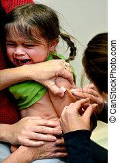 Child immunisation - TAIPA, NZL - MAY 16 2014:A child (Talya...