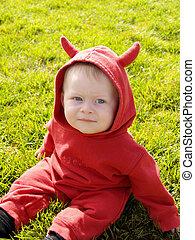 Child in a devil costume