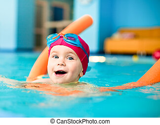Child in a swimming pool - Happy little girl learning to ...