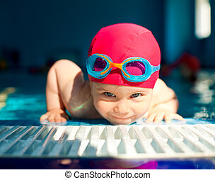 Child in a swimming pool - Happy little girl looking out...