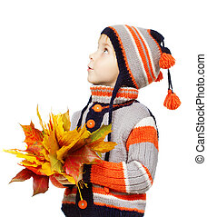 Child in autumn leaves. Maple fall over white