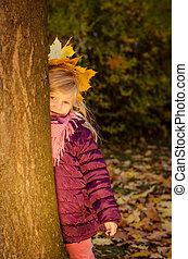 child in autumn season
