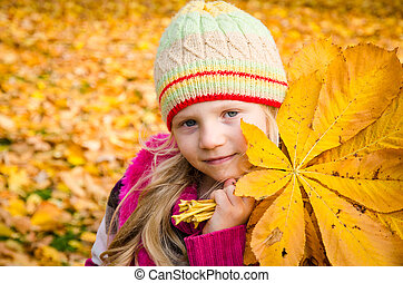 child in autumn time