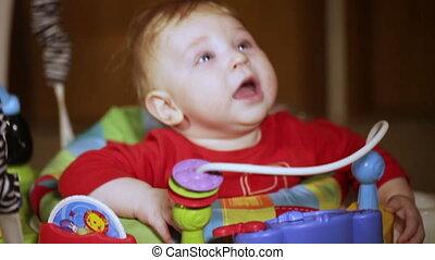 Child in baby walker