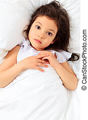 child in bed - Sweet little girl is going to sleep in a bed....