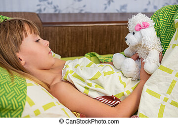 child in bed with dog