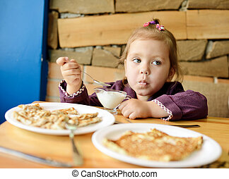 child in cafe