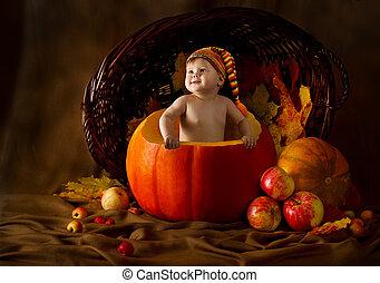 Child in cap inside pumpkin, autumn