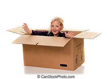 Child in cardboard box. Is moving to shafts