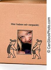 Child in cardboard box.