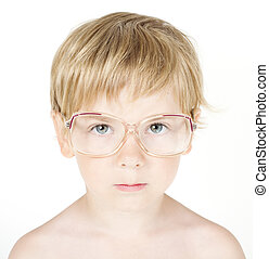 Child in eyeglasses. Close up portrait