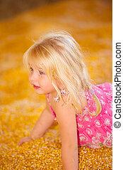 Child in Fall Harvest Corn