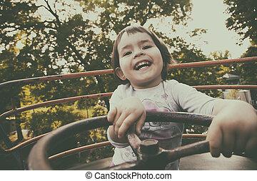 Child in Ferris wheel